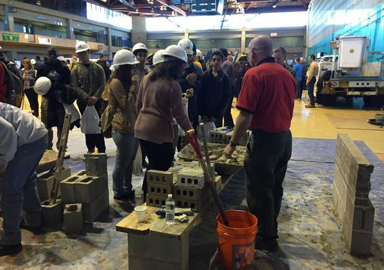 Students from Lincoln High School in Yonkers learn what it's like to lay concrete blocks at the 2015 Hudson Valley Construction Career Day, held Thursday at Rockland Community College. (Photo: Khurram Saeed/The Journal News)