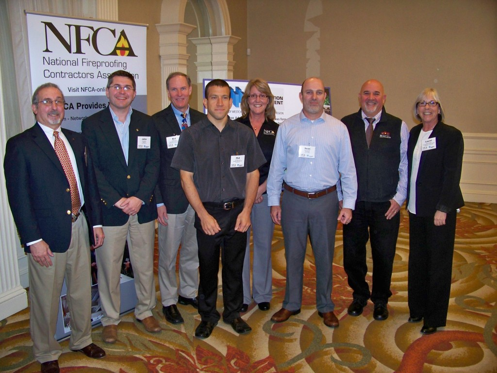 From left, Richard Ferrara, Architectural Services of the USG Corporation, NY; John Dalton, technical service manager of W. R. Grace & Co. of Cambridge, MA; Bill McHugh, executive director of the National Fireproo ng Contractors Association of Hillside, IL; Phil Mancusco, technical services manager of Isolatek International of Stanhope, NJ; Sandy Addison, associate executive director of the National Fireproo ng Contractors Association of Hillside, IL; Sean Younger, senior market manager-Fireproo ng of Carboline of St. Louis, MO; Jonathan Wohl, trustee of the Construction Advancement Institute in Tarrytown, NY; and Laurel Brunelle, program director of the Construction Advancement Institute in Tarrytown, NY.
